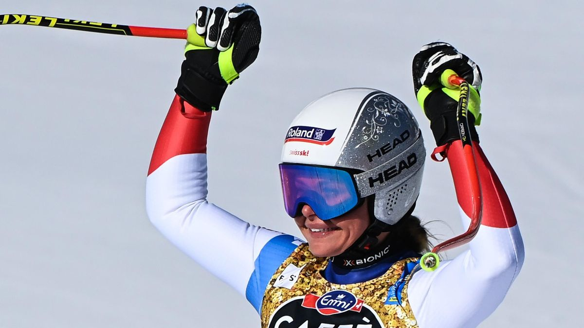 Switzerland's Corinne Suter reacts as she crosses the finish line in the Women's Downhill on February 13, 2021 during the FIS Alpine World Ski Championships in Cortina d'Ampezzo, Italian Alps