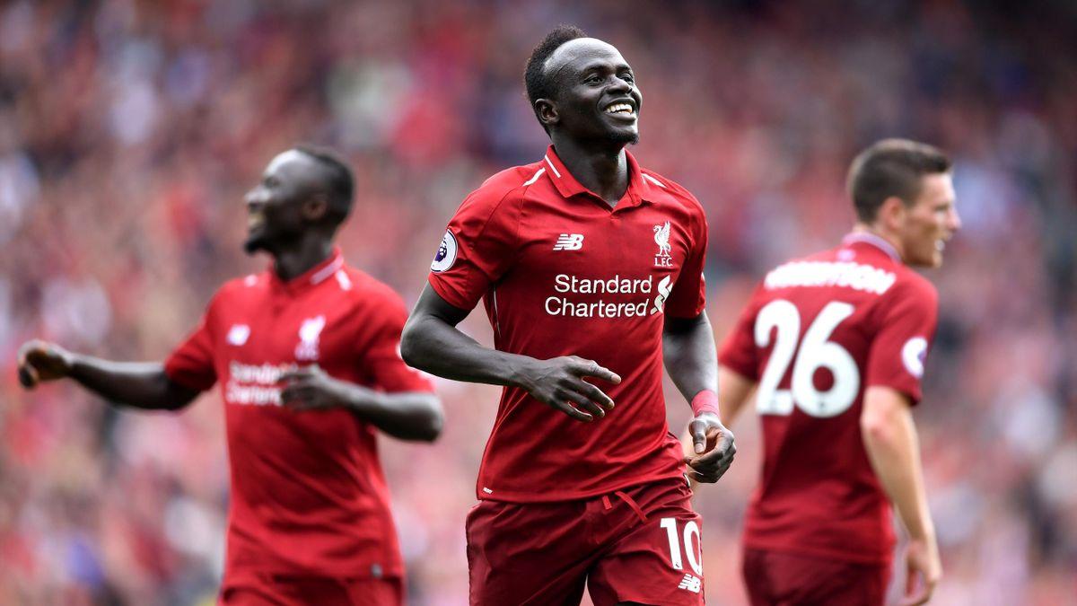 Sadio Mane of Liverpool celebrates after scoring his team's third goal
