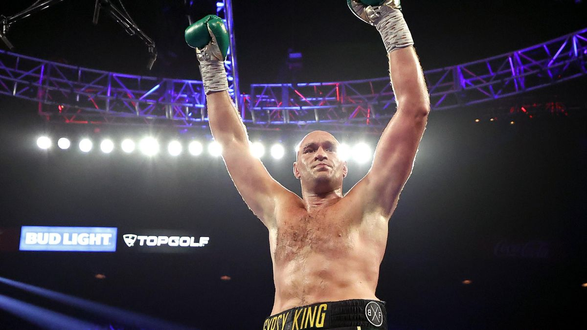 Tyson Fury celebrates after knocking down Deontay Wilder during their Heavyweight bout for Wilder's WBC and Fury's lineal heavyweight title on February 22, 2020 at MGM Grand Garden Arena in Las Vegas, Nevada