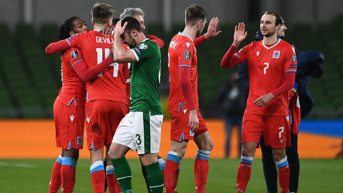 Luxembourg's striker Gerson Rodrigues (L) celebrates with teammates at the final whistle during the FIFA World Cup Qatar 2022 group A qualification football match between Ireland and Luxembourg at Aviva Stadium in Dublin on March 27, 2021