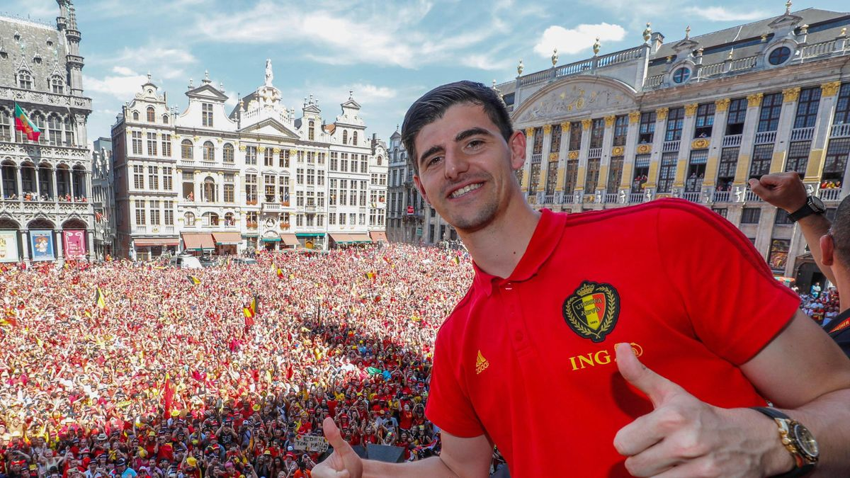 Belgium's goalkeeper Thibaut Courtois celebrates at the Grand Place/Grote Markt in Brussels city center, as Belgian national football team Red Devils arrive to celebrate with supporters at the balcony of the city hall after reaching the semi-finals and wi
