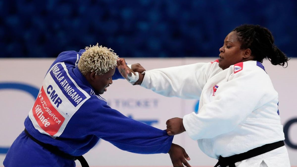 Idalys Ortiz (white) of Cuba and Hortence Vanessa Mballa Atangana (blue) of Cameroon compete in the Women's +78kg Pool A third round on day seven of the World Judo Championships at the Nippon Budokan on August 31, 2019 in Tokyo, Japan. (Photo by Kiyoshi O
