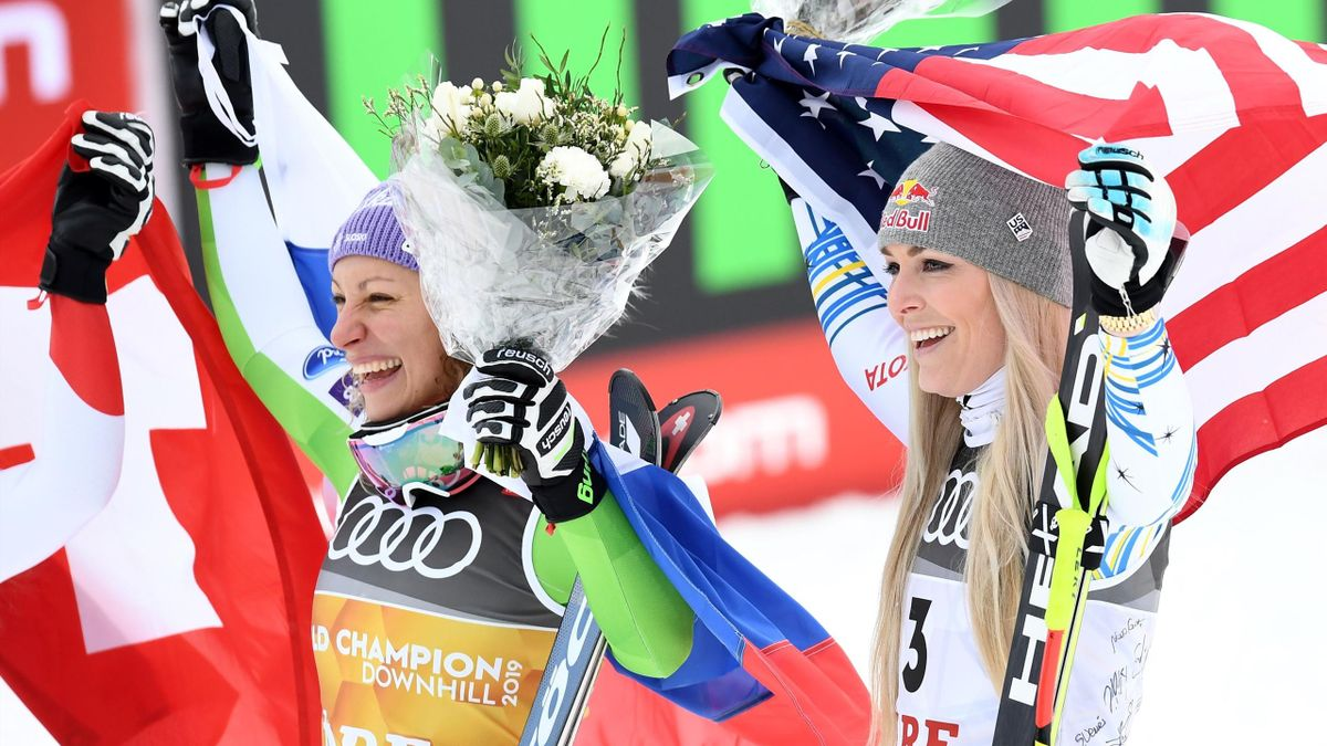 Slovenia's winner Ilka Stuhec (L) and third placed US' Lindsey Vonn celebrate during the flowers ceremony after the Women's Downhill event of the 2019 FIS Alpine Ski World Championships