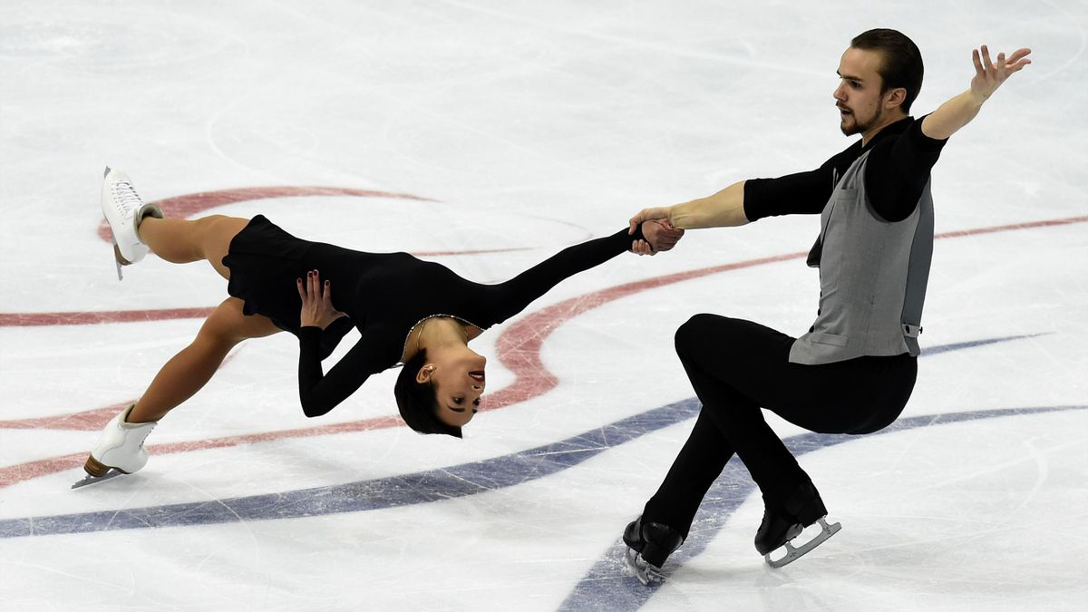 Russia's Ksenia Stolbova and Fedor Klimov perform during the pairs short skating program at the ISU Grand Prix Figure skating Rostelekom Cup in Moscow on November 20, 2015