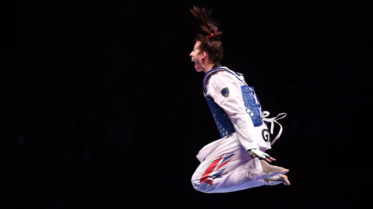 Bianca Walkden of Great Britain celebrates victory against Shuyin Zheng of China in the Final of the Women's +73kg during Day 3 of the World Taekwondo Championships at Manchester Arena on May 17, 2019 in Manchester, England