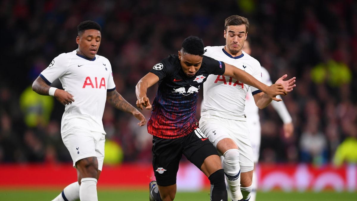 Christopher Nkunku of RB Leipzig and Harry Winks of Tottenham Hotspur during the UEFA Champions League round of 16 first leg match between Tottenham Hotspur and RB Leipzig at Tottenham Hotspur Stadium on February 19, 2020 in London, United Kingdom.
