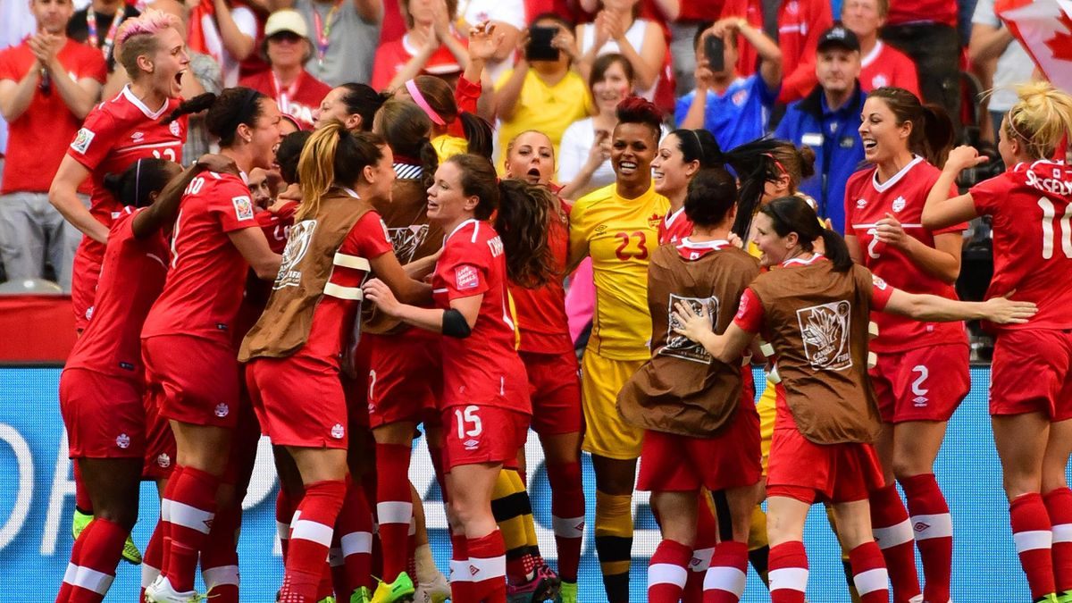 ; Canada players celebrate at the end of their 1-0 victory over Switzerland in the round of sixteen in the FIFA 2015 women's World Cup soccer tournament at BC Place Stadium