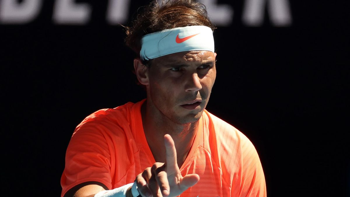 Spain's Rafael Nadal gestures towards Serbia's Laslo Djere during their men's singles match on day two of the Australian Open tennis tournament in Melbourne