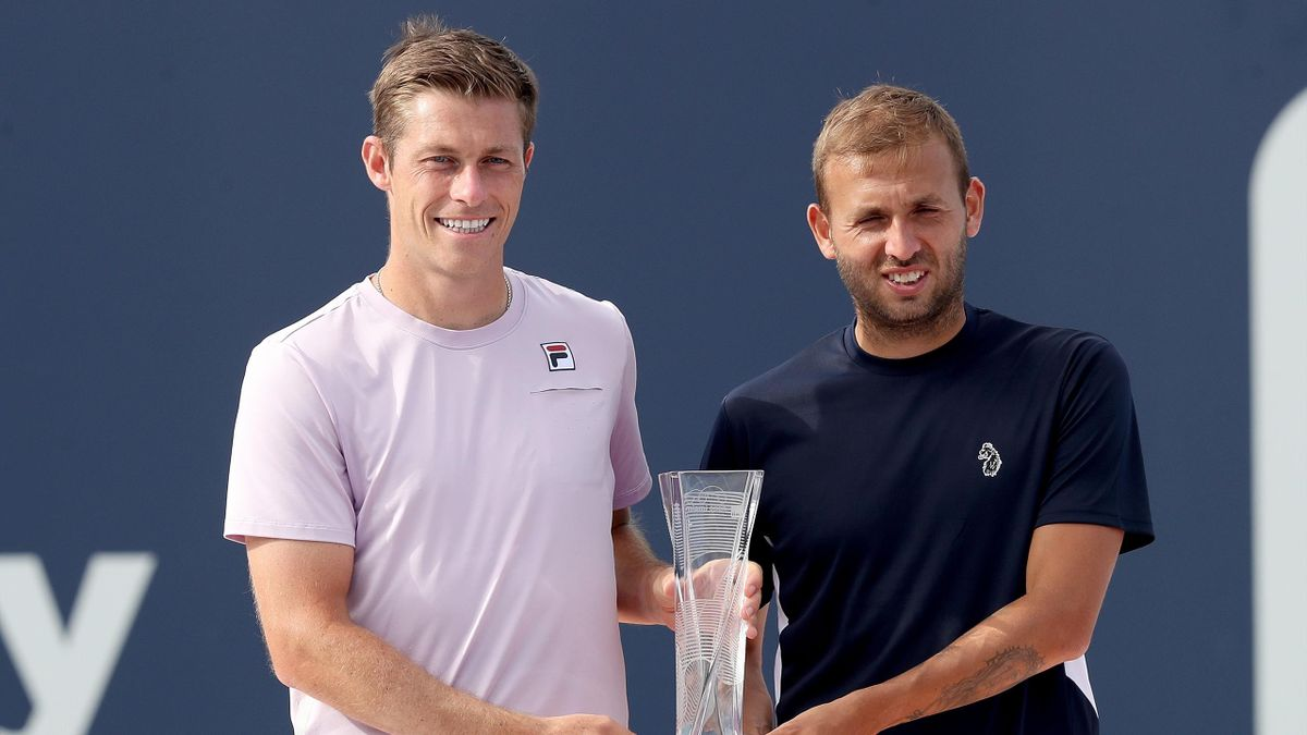 Neal Skupski (L) and Daniel Evans (R) pose with the runner's up trophy