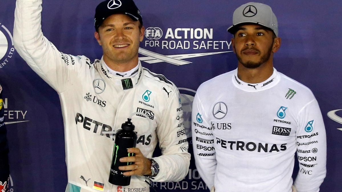 Mercedes' Nico Rosberg of Germany celebrates pole position next to Mercedes' Lewis Hamilton of Britain.