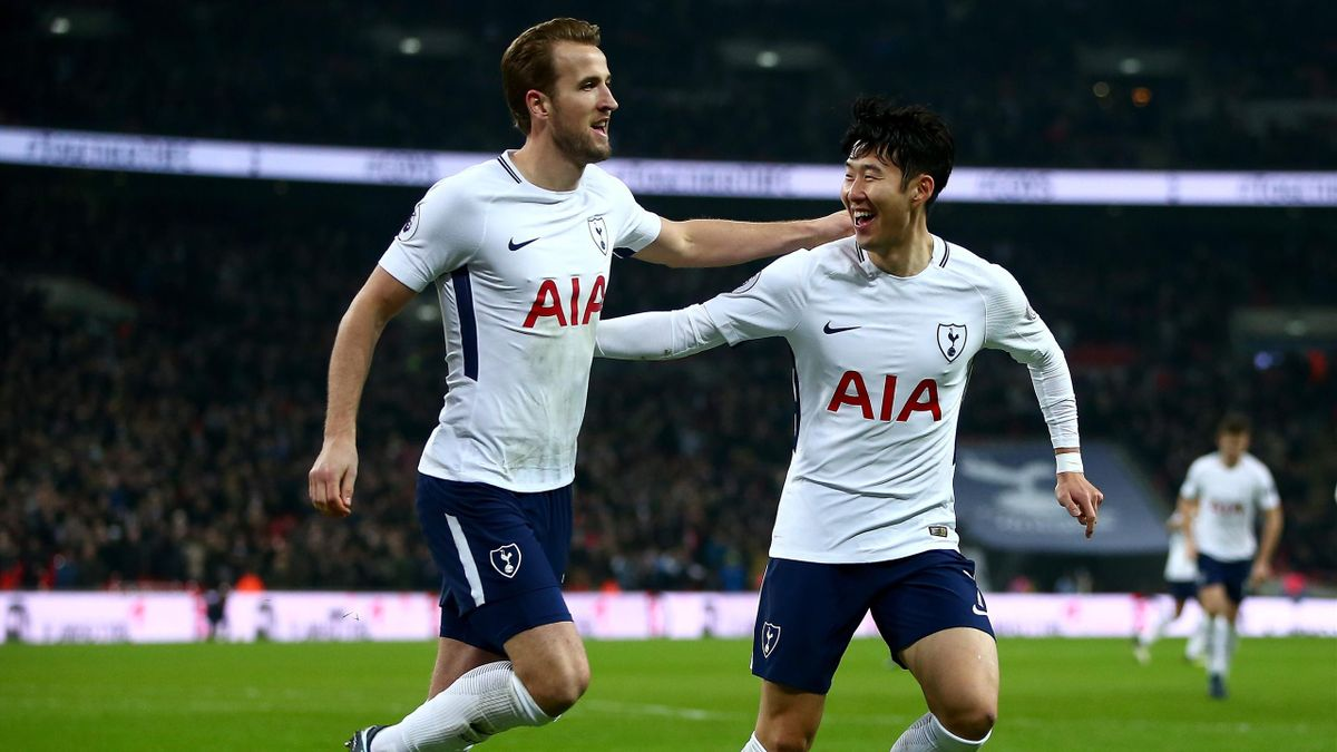 Harry Kane of Tottenham Hotspur celebrates with teammate Heung-Min Son after scoring his sides second goal against Everton