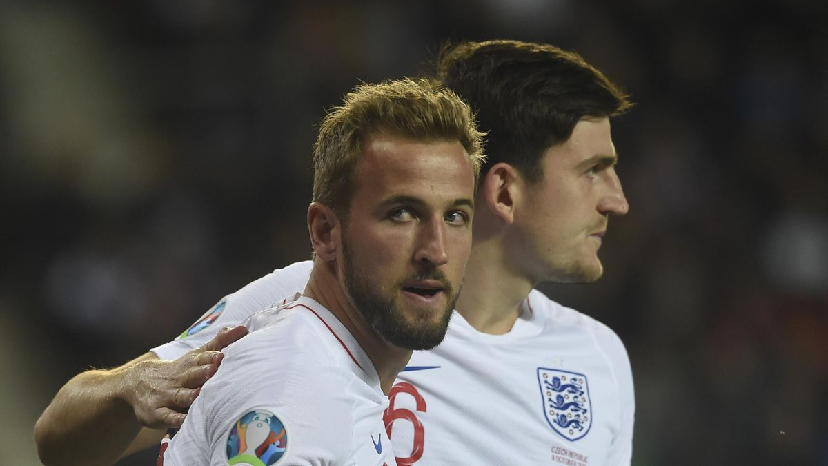 England's Harry Kane celebrates with his team mate Harry Maguire during the UEFA Euro 2020 qualifier Group A football match Czech Republic and England on October 11, 2019 at the Sinobo Arena in Prague.