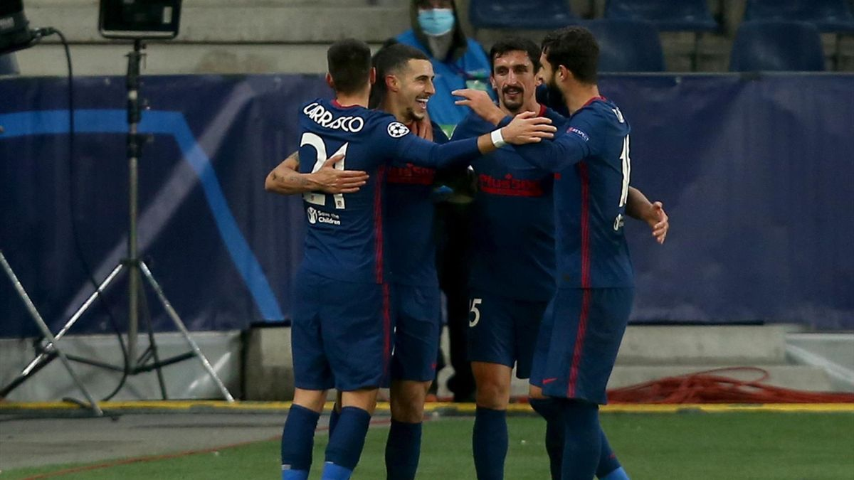 Mario Hermoso of Atletico Madrid celebrates after scoring his team's first goal with teammates during the UEFA Champions League Group A stage match between RB Salzburg and Atletico Madrid at Red Bull Arena on December 9, 2020 in Salzburg, Austria