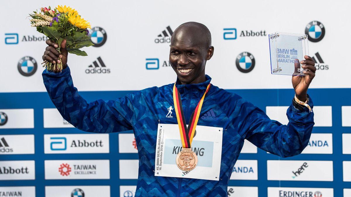 Wilson Kipsang of Kenya celebrates at the podium after finishing third during the Berlin Marathon 2018 on September 16, 2018 in Berlin