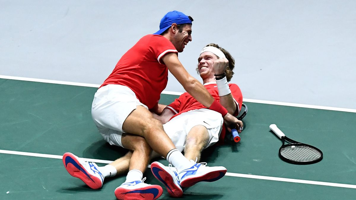Russia's Karen Khachanov (L) and Russia's Andrey Rublev celebrate after winning the quarter-final doubles tennis match between Serbia and Russia at the Davis Cup Madrid Finals 2019 in Madrid