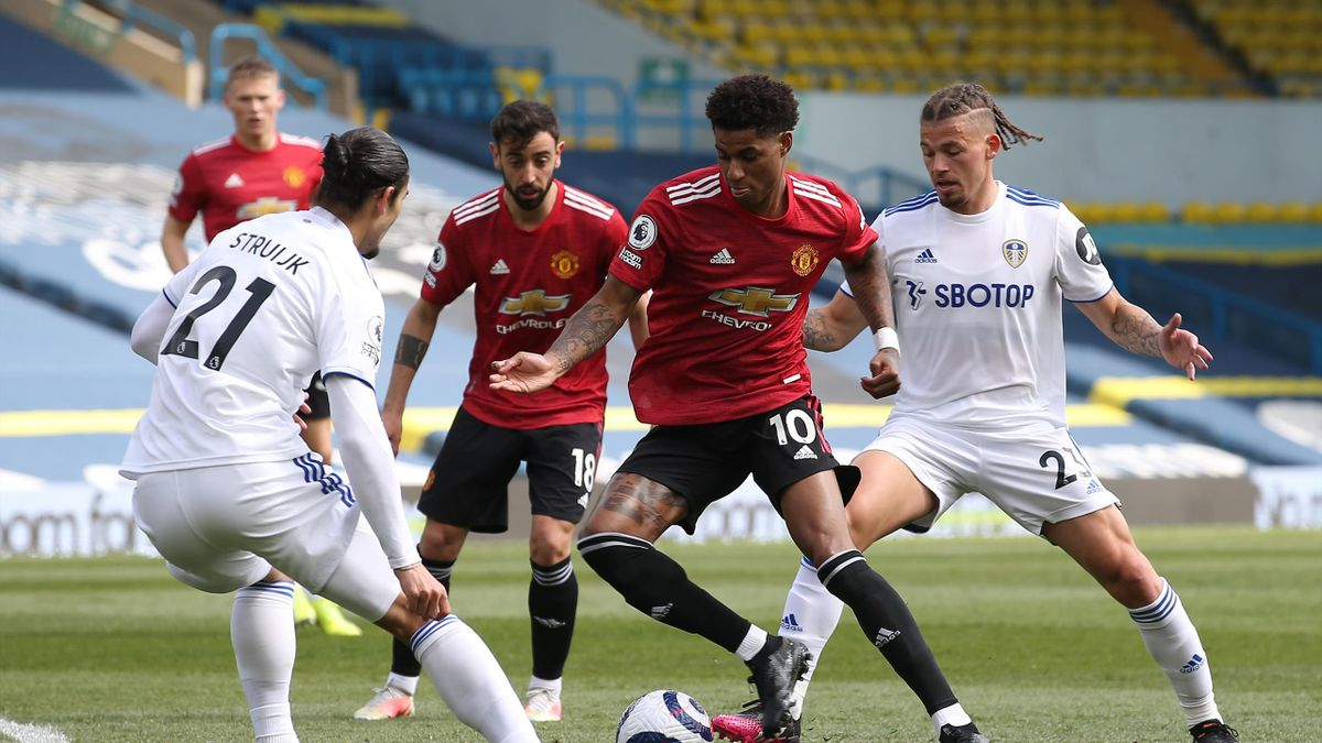 Marcus Rashford of Manchester United in action with Pascal Struijk and Kalvin Phillips of Leeds United during the Premier League match between Leeds United and Manchester United at Elland Road