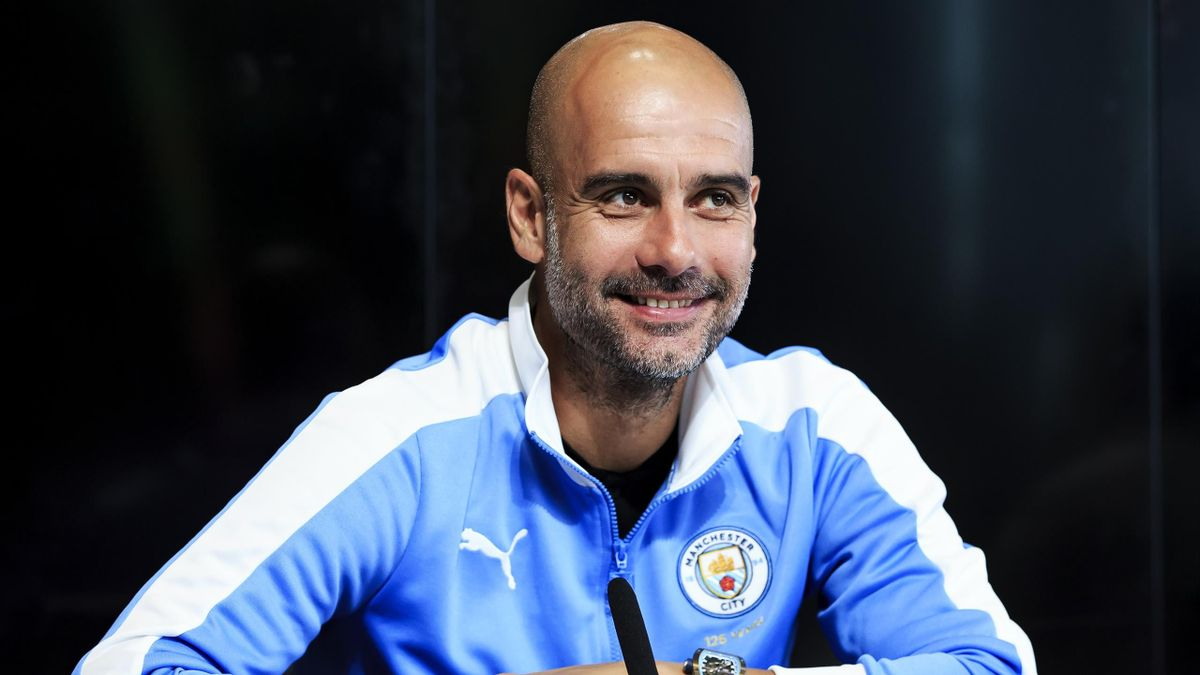 Pep Guardiola, manager of Manchester City addresses the media
