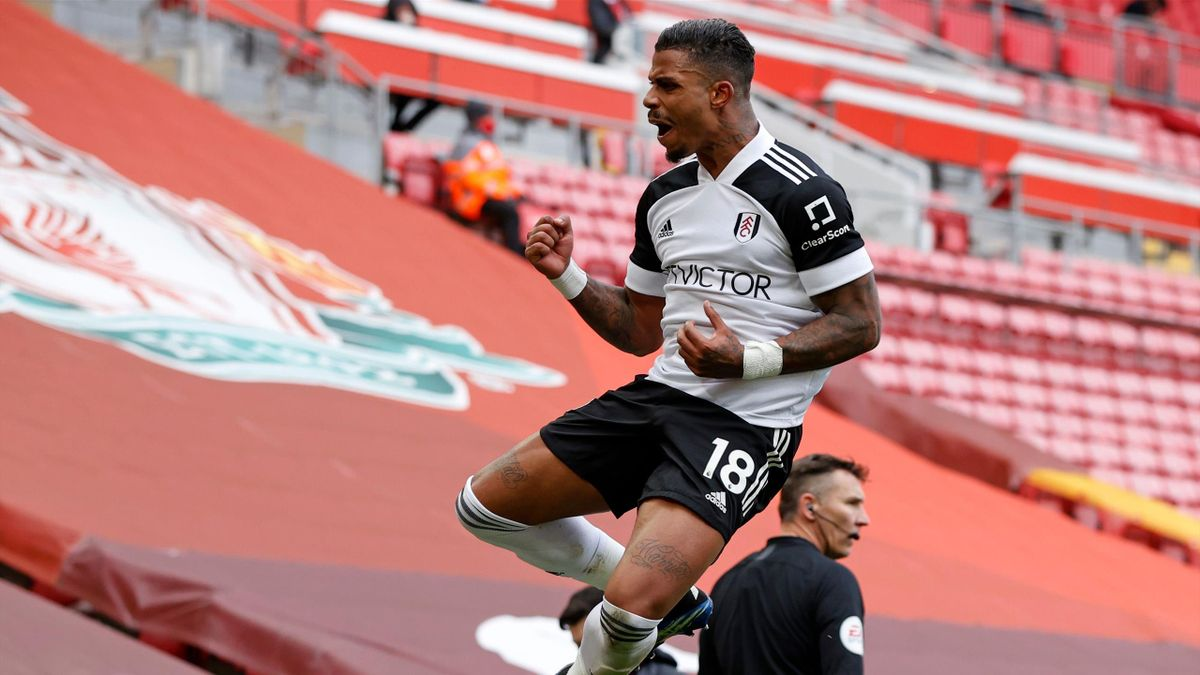 Fulham's Gabonese midfielder Mario Lemina (C) celebrates after scoring the opening goal of the English Premier League football match between Liverpool and Fulham at Anfield