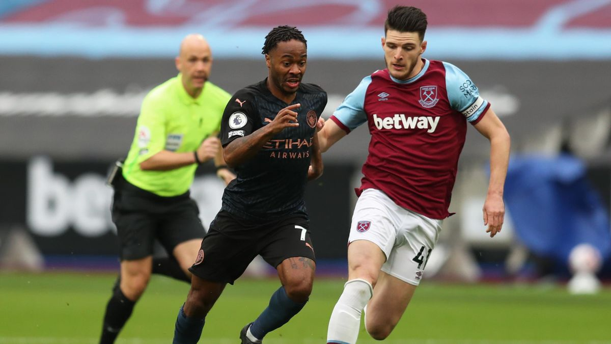Raheem Sterling of Manchester City battles for possession with Declan Rice of West Ham United