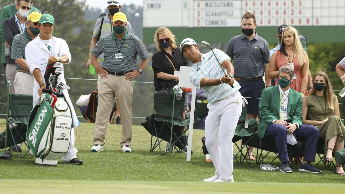 Hideki Matsuyama of Japan hits his third shot on the ninth hole during the third round of the Masters Tournament on 10 April 2021, at Augusta National Golf Club in Augusta, Georgia..