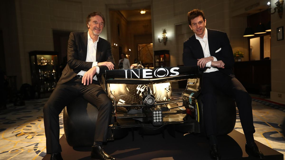 INEOS Founder and Chairman Sir Jim Ratcliffe (L) and Toto Wolff, Team Principal & CEO of The Mercedes AMG-PETRONAS F1 Team (R) pose for a photo with a Mercedes F1 car and it's 2020 livery during a press conference regarding INEOS and Mercedes future partn