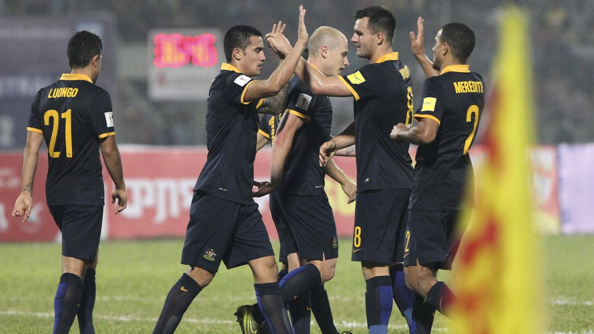 ustralia's Tim Cahill (2nd L) is congratulated after scoring a goal during their World Cup qualifier against Bangladesh.