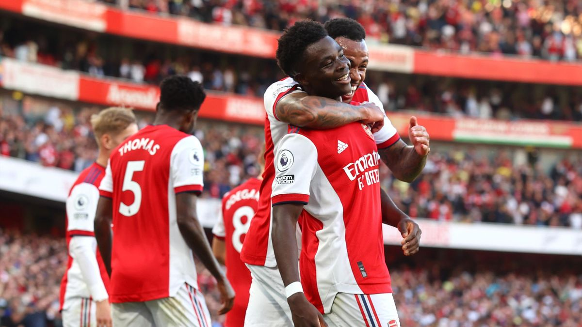 Bukayo Saka of Arsenal celebrates after scoring their side's third goal during the Premier League match between Arsenal and Tottenham Hotspur at Emirates Stadium on September 26, 2021 in London, England