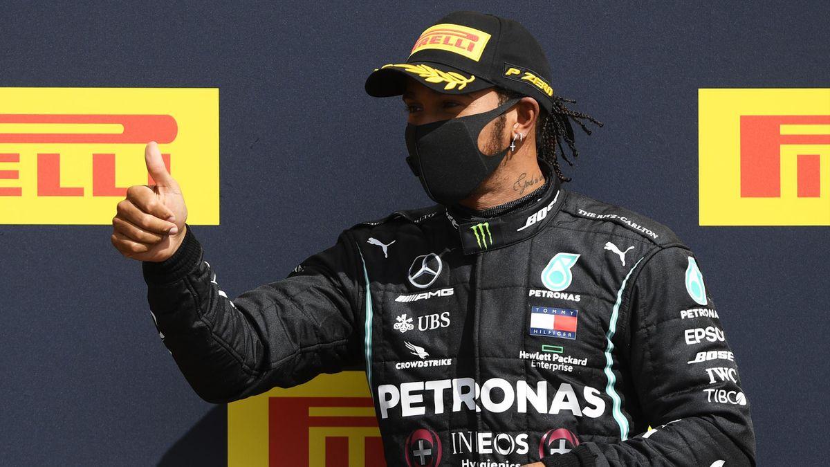 Lewis Hamilton celebrates winning the British GP at Silverstone