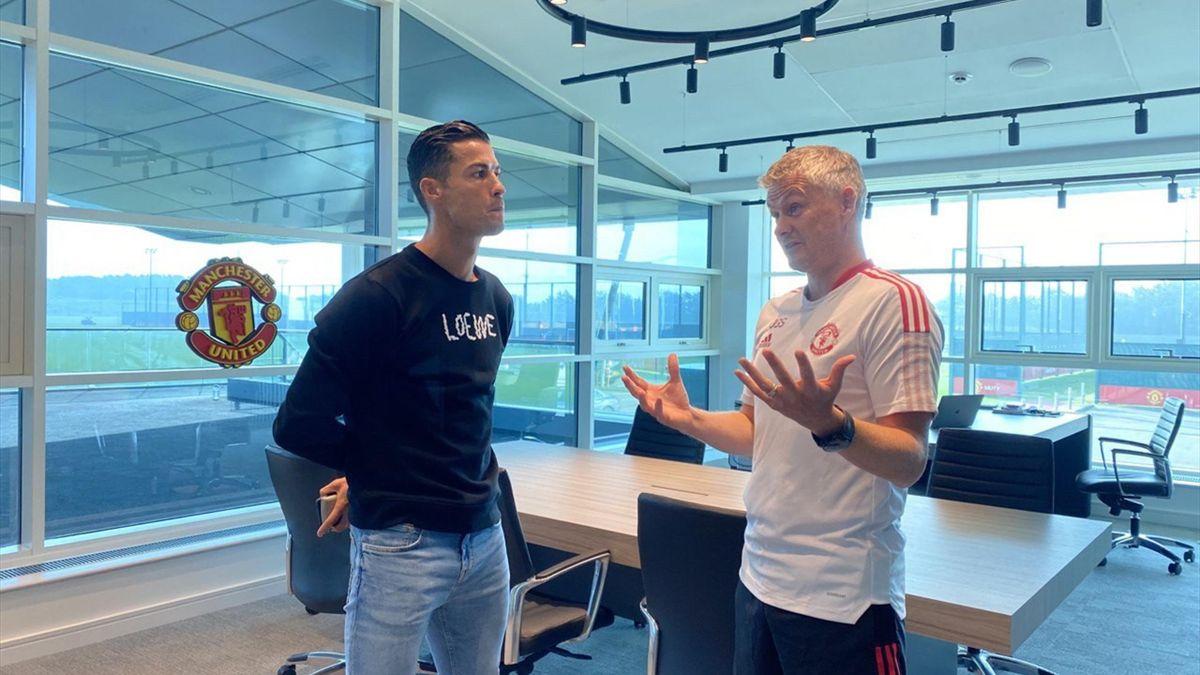 Ole Gunnar Solskjaer talks to Cristiano Ronaldo at Manchester United's training base, Carrington, Manchester, September 7, 2021