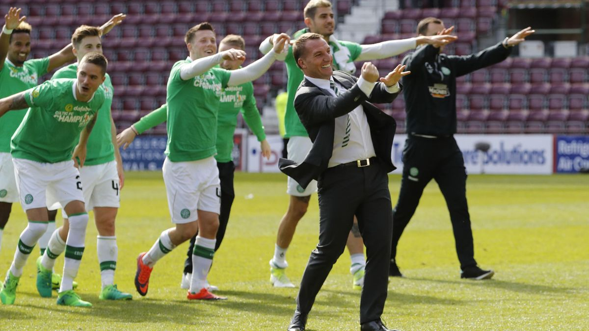 Celtic manager Brendan Rodgers and their players celebrate winning the Scottish Premiership.