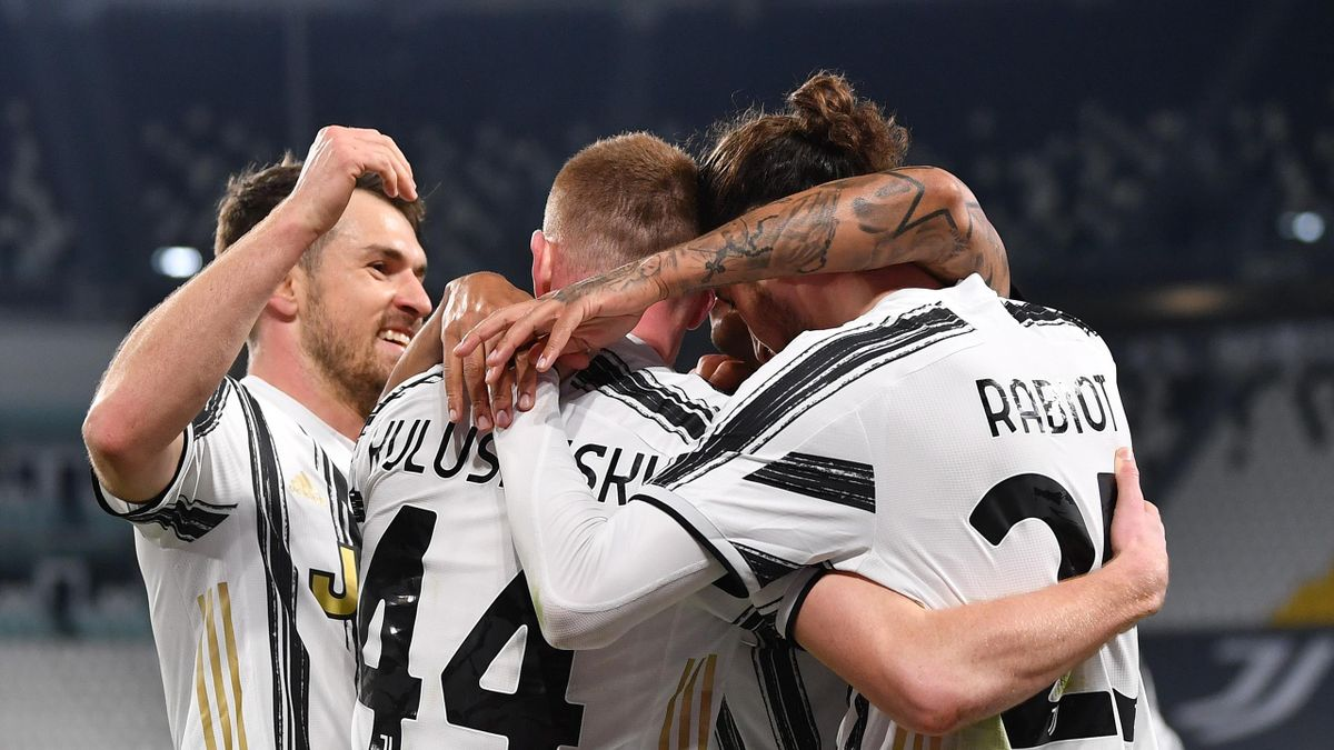 Adrien Rabiot of Juventus celebrates with teammate Dejan Kulusevski and Aaron Ramsey after scoring their team's first goal during the Serie A match between Juventus and SS Lazio at Allianz Stadium on March 06, 2021 in Turin, Italy.