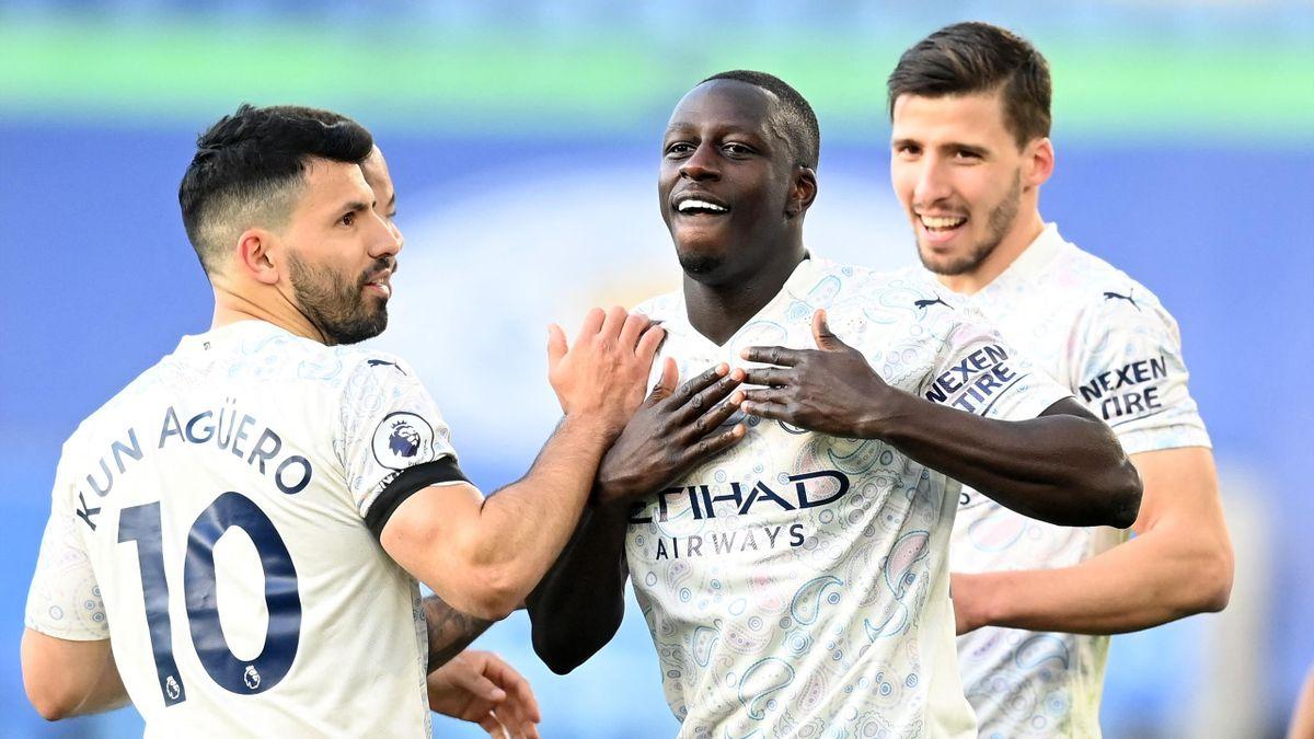 Manchester City's French defender Benjamin Mendy (C) celebrates scoring the opening goal