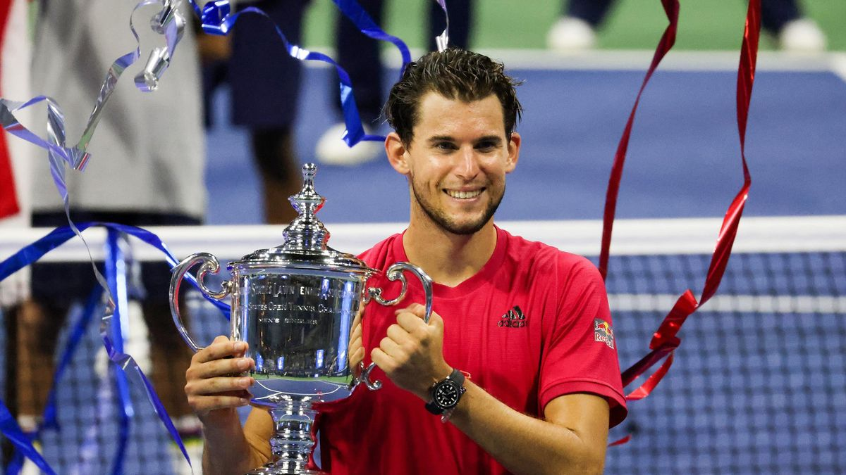 Dominic Thiem of Austria celebrates with the championship trophy after winning in a tie-breaker during his Men's Singles final match against Alexander Zverev of Germany on Day Fourteen of the 2020 US Open at the USTA Billie Jean King National Tennis Cente