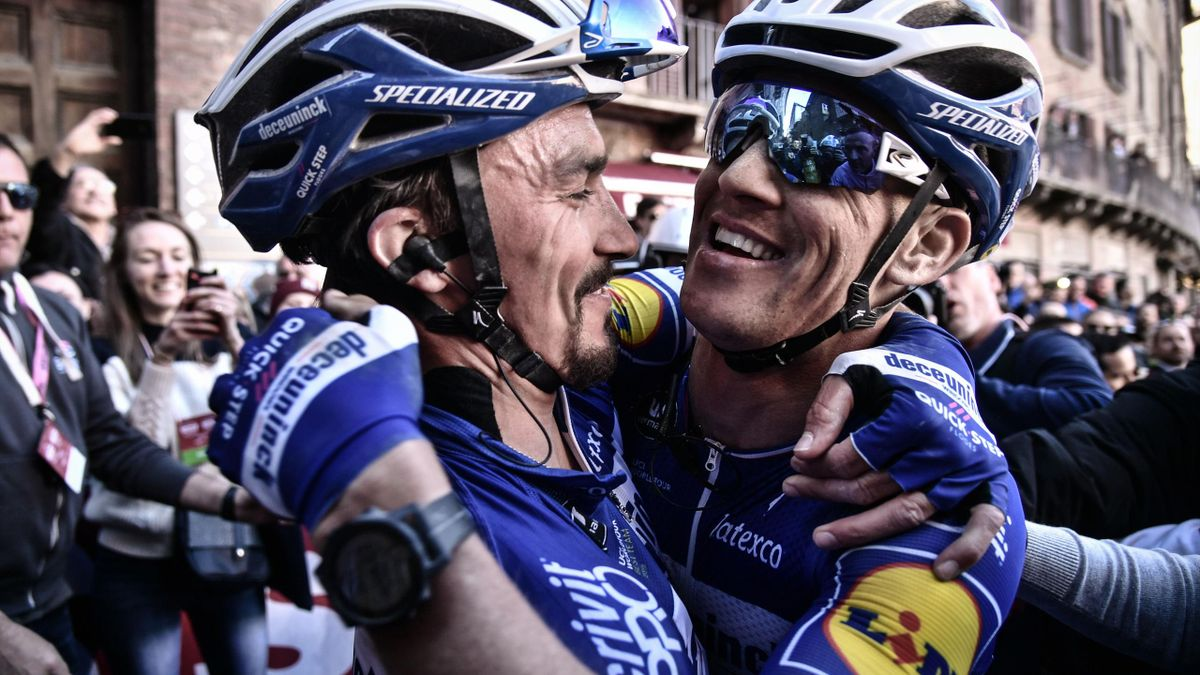 France's Julian Alaphilippe (L) embraces Czech teammate Zdenek Stybar after winning the one-day classic cycling race Strade Bianche