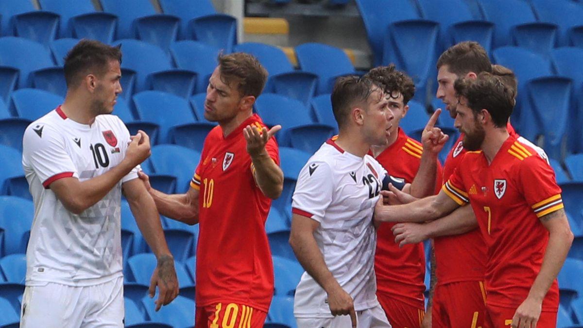 Albania's forward Rey Manaj (L) and Albania's midfielder Amir Abrashi (3L) confront , Wales' midfielder Aaron Ramsey (2L), Wales' midfielder Joe Allen (R), Wales' defender Ben Davies (2R) and Wales' defender Neco Williams (3R) during the international fri