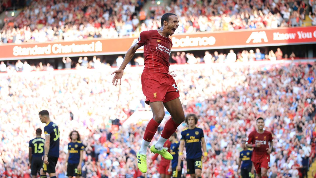 Joel Matip of Liverpool celebrates after scoring their 1st goal during the Premier League match between Liverpool and Arsenal at Anfield