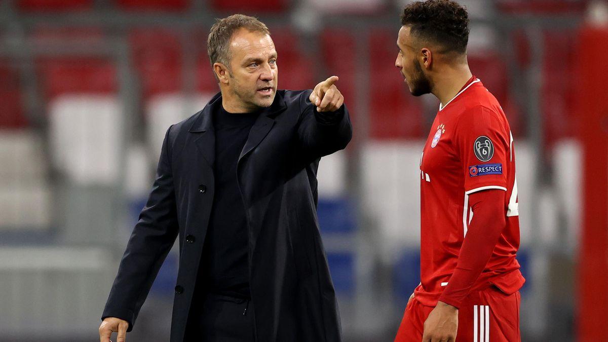 Hans-Dieter Flick mit Corentin Tolisso vom FC Bayern