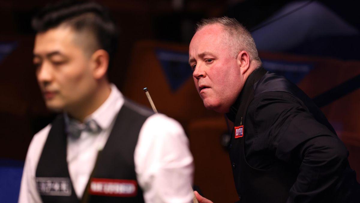 John Higgins watches Tian Pengfei play a shot, World Snooker Championship, Crucible Theatre, April 18, 2021 in Sheffield, England