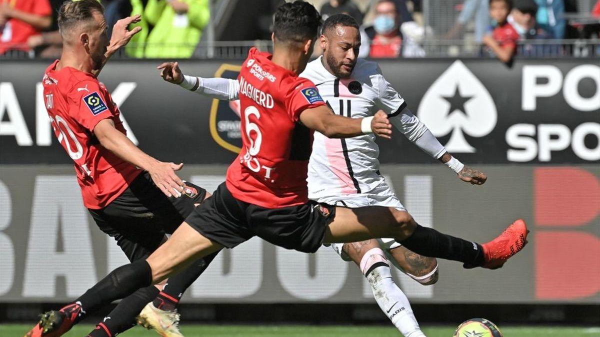 Paris Saint-Germain's Brazilian forward Neymar kicks the ball (R) during the French L1 football match between Stade Rennais (Rennes) and Paris Saint-Germain at the Roazhon Park in Rennes on October 3, 2021