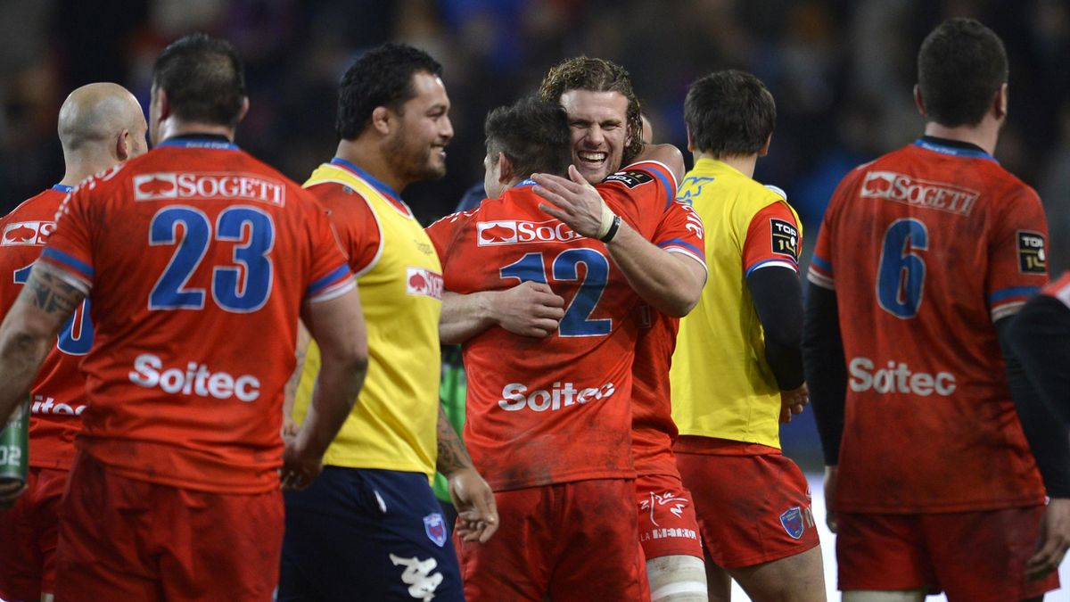 Grenoble flanker Fabien Alexandre (C) celebrates with team-mates after beating Clermont Auvergne (AFP)