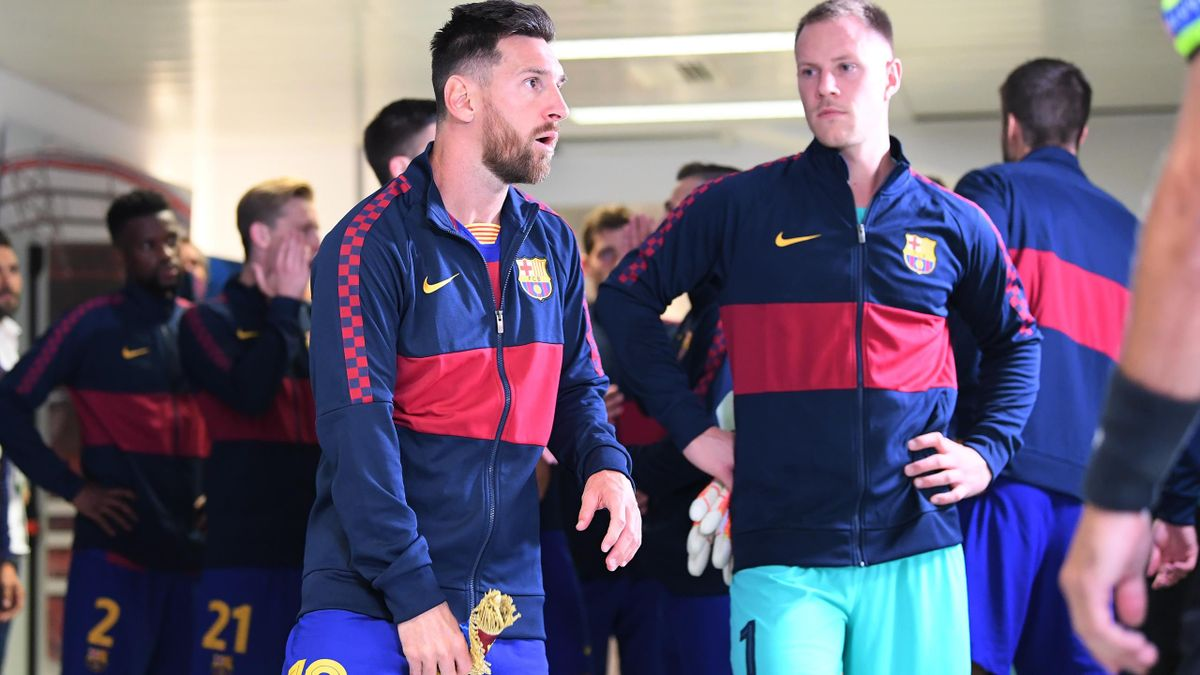 Lionel Messi and Marc-Andre ter Stegen of FC Barcelona waits in the tunnel ahead of the team before the UEFA Champions League Quarter Final match between Barcelona and Bayern Munich