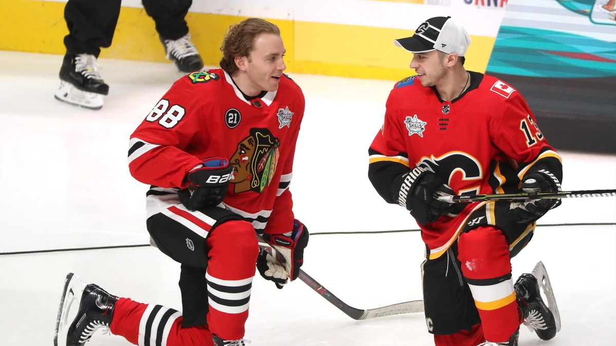Patrick Kane #88 of the Chicago Blackhawks and Johnny Gaudreau #13 of the Calgary Flames talk after competing in the Gatorade NHL Puck Control during the 2019 SAP NHL All-Star Skills