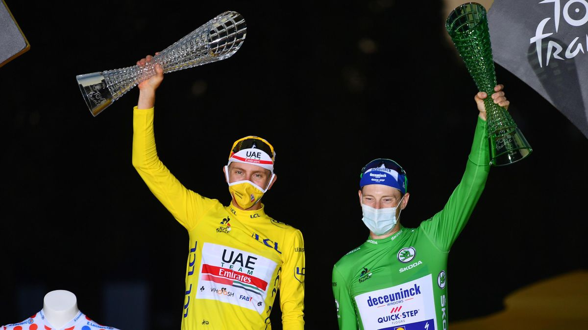 Tadej Pogacar of Slovenia and UAE Team Emirates Yellow Leader Jersey, White Best Young Rider Jersey and Polka Dot Mountain Jersey / Sam Bennett of Ireland and Team Deceuninck - Quick-Step Green Points Jersey / Celebration / Trophy / during the 107th Tour
