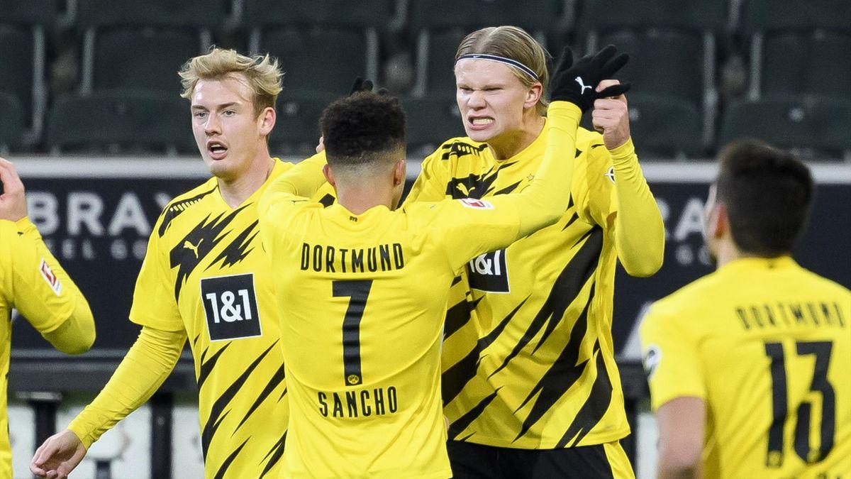 Erling Haaland of Borussia Dortmund with Julian Brandt of Borussia Dortmund and Jadon Sancho