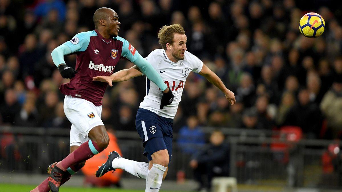 Angelo Ogbonna of West Ham pursues Tottenham's Harry Kane