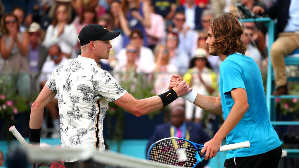 Kyle Edmund of Great Britain and Stefanos Tsitsipas of Greece shake hands at the net after their First Round Singles Match during day Four of the Fever-Tree Championships at Queens Club on June 20, 2019 in London, United Kingdom.