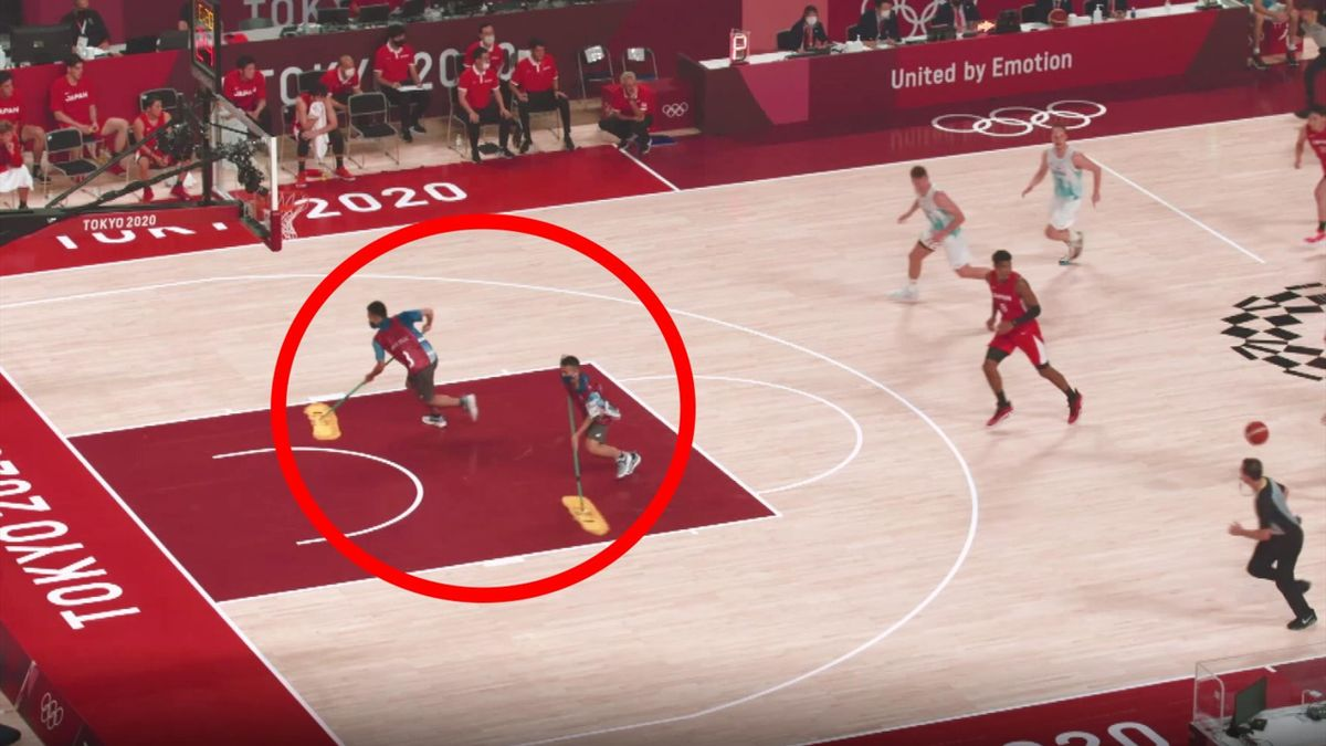 Watch crazy moment confused cleaners almost collide with stars during basketball match