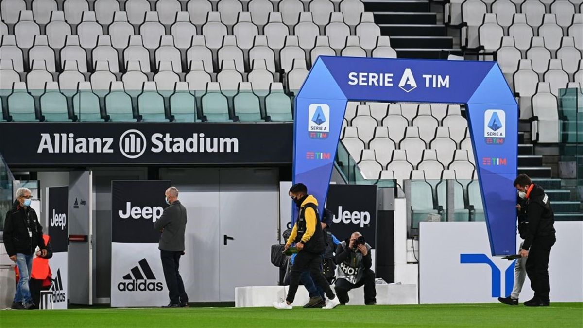 Workers remove the archway structure under which players usually enter the pitch before the start of the game, on October 4, 2020 at the Juventus stadium in Turin, prior to the Italian Serie A football match Juventus vs Napoli, still scheduled following L