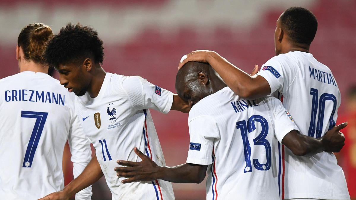 N'Golo Kante (2R) celebrates his goal