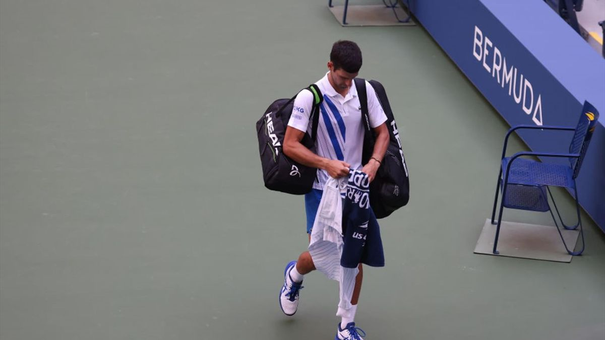 Novak Djokovic of Serbia walks off the court after being defaulted due to inadvertently striking a lineswoman with a ball hit in frustration during his Men's Singles fourth round match against Pablo Carreno Busta of Spain on Day Seven of the 2020 US Open